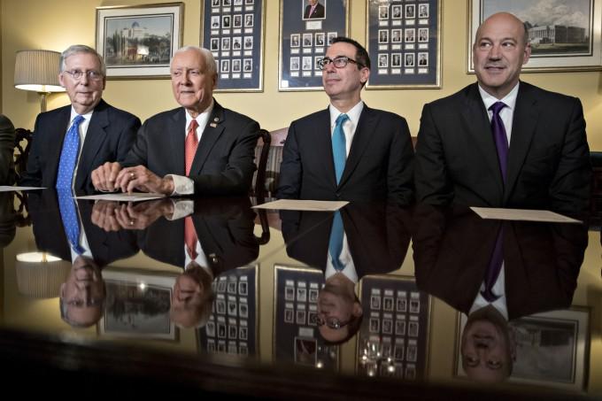 Senate Majority Leader Mitch McConnell, R-Ken., Senate Finance Committee chairman Orrin Hatch, R-Utah, Treasury Secretary Steven Mnuchin, and U.S. National Economic  Council director Gary Cohn