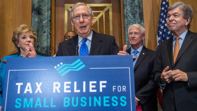 Senate Majority Leader Mitch McConnell, R-Ken., surrounded by fellow Republican senators